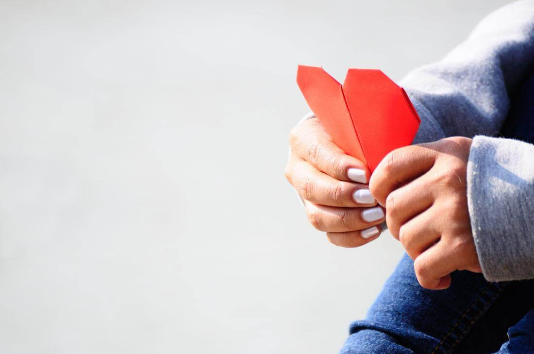 woman holding paper heart
